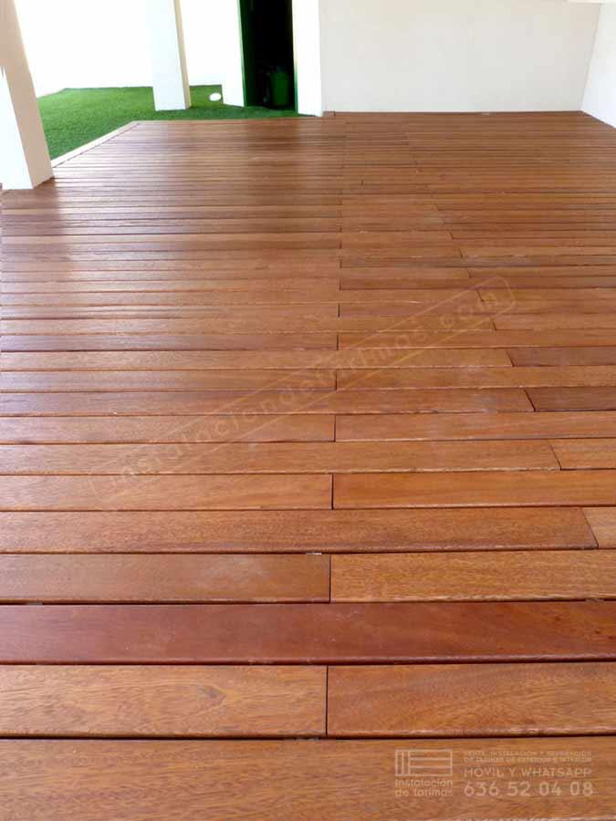 Foto de suelo de elondo con tarima exterior con grapa vista